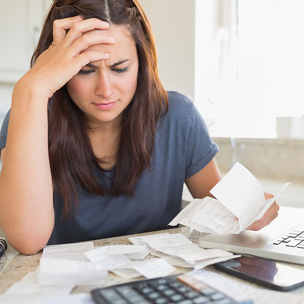 Woman looking concerned about her bills