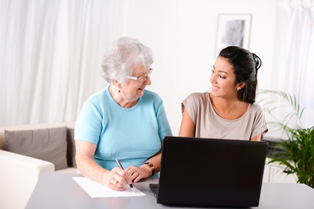 Two women using laptop