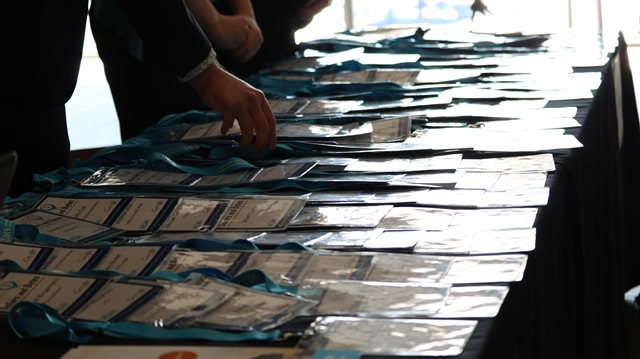 Conference name tags laid out on registration desk