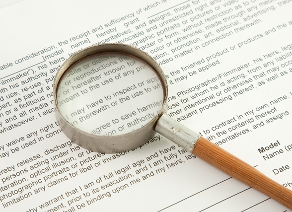 Magnifying glass on top of document