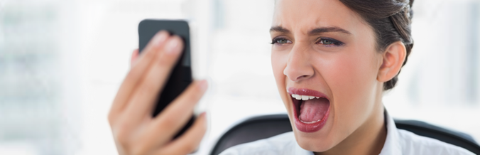 Picture of woman screaming at mobile phone