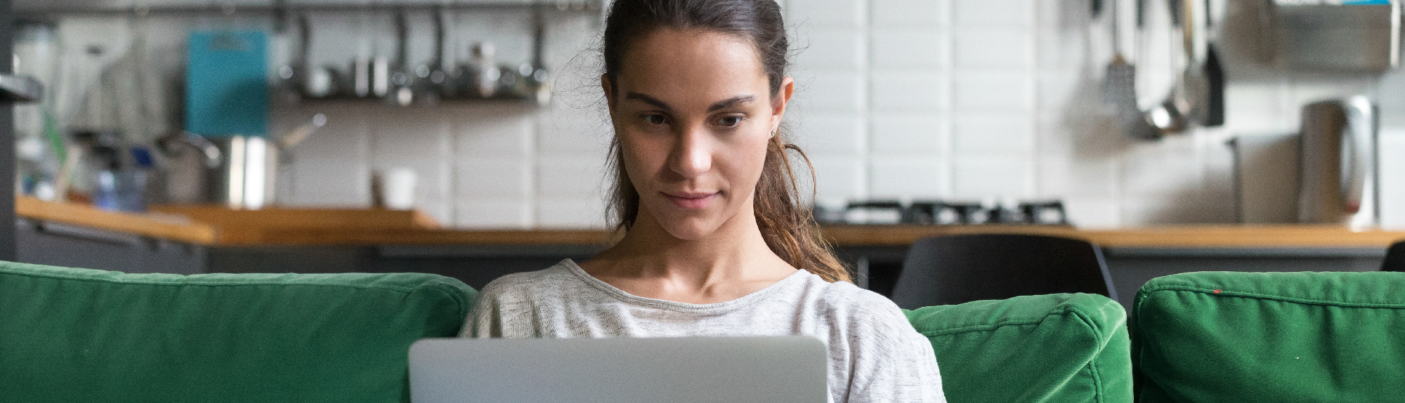 Woman reading Hot Issues Blog on computer