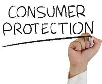 Hand writing 'consumer protection' on clear panel with marker