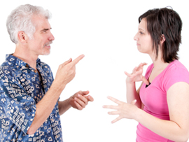 Picture of a man and a woman using Australian sign language to talk.