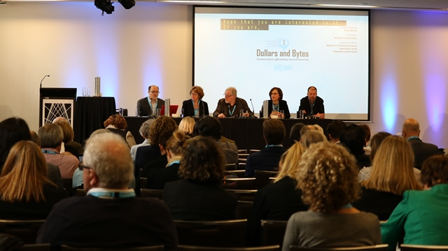 Image of audience and Conference panel
