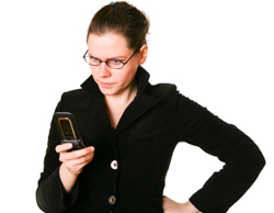 Picture of woman looking at mobile phone in frustration