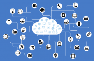 Blue background with white cloud in centre, lines extending from cloud with bubbles featuring pieces of technology