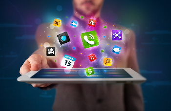 Man holding a tablet with App icons floating out.